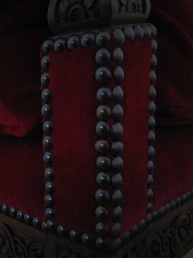 Photo: Detail of the decorative nailing on the corner of the chair